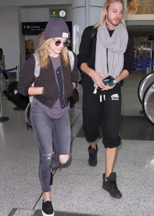 Chloe Moretz in Ripped Jeans - Arriving at LAX Airport in Los Angeles