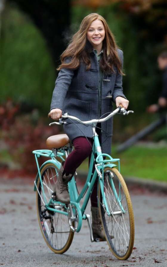 Chloe Moretz riding a bike on the set of If I Stay -12