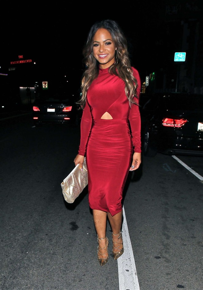 Christina Milian in Tight Red Dresas Out in the evening in LA