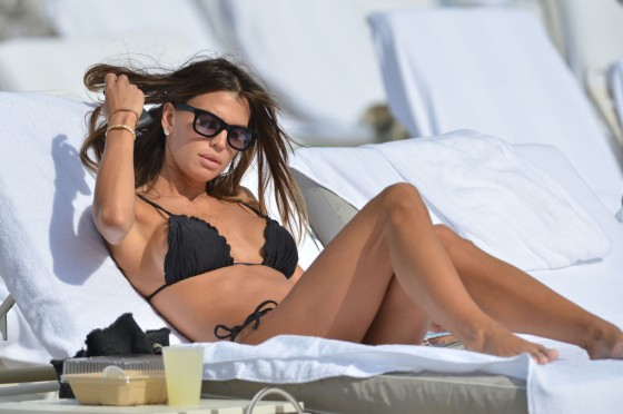 Claudia Galanti - Black bikini candids on the beach in Miami