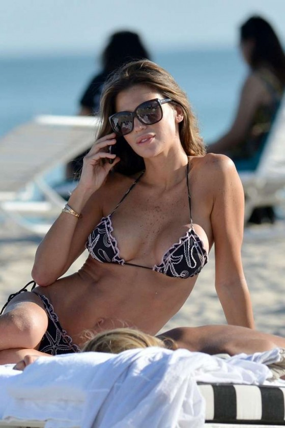 Claudia Galanti sunbathing in bikini on the beach in Miami