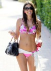 Claudia Romani in pink-white bikini after a day on the beach in Miami
