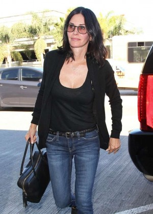 Courteney Cox in Tight Jeans at LAX Airport in Los Angeles