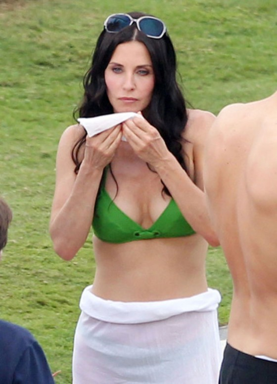 Courteney Cox In Green Bikini On Set Of Cougar Town In Hawaii.