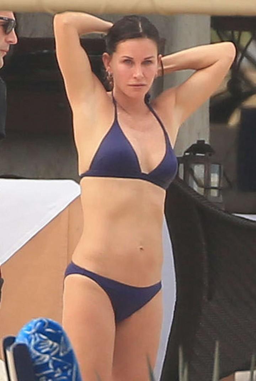 Courteney Cox – Wearing black bikini in Cabo