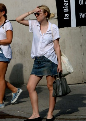 Dakota Fanning in Jeans Skirt out in NYC
