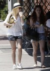 Dakota Fanning shows her Legs in denim shorts in Los Angeles