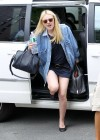 Dakota Fanning shows her legs in mini dress in New York