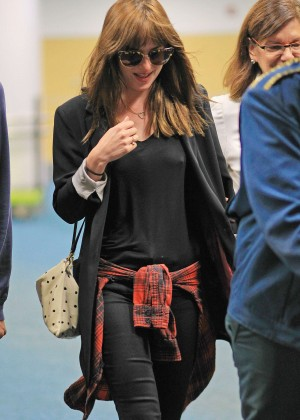 Dakota Johnson in Tight Jeans at the Vancouver International Airport