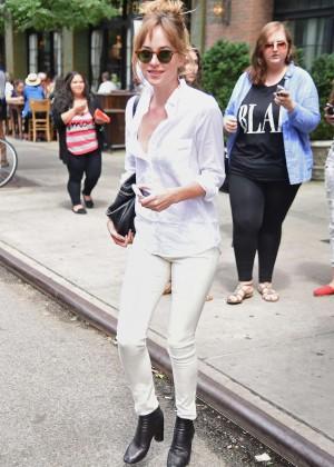 Dakota Johnson in White Pants out in New York