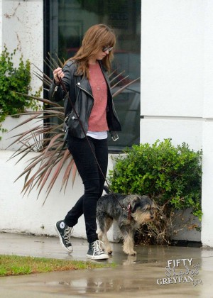 Dakota Johnson in Black Jeans walks her dog in Los Angeles