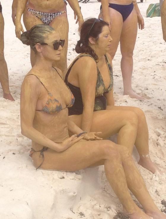 Demi Moore covered in mud in bikini