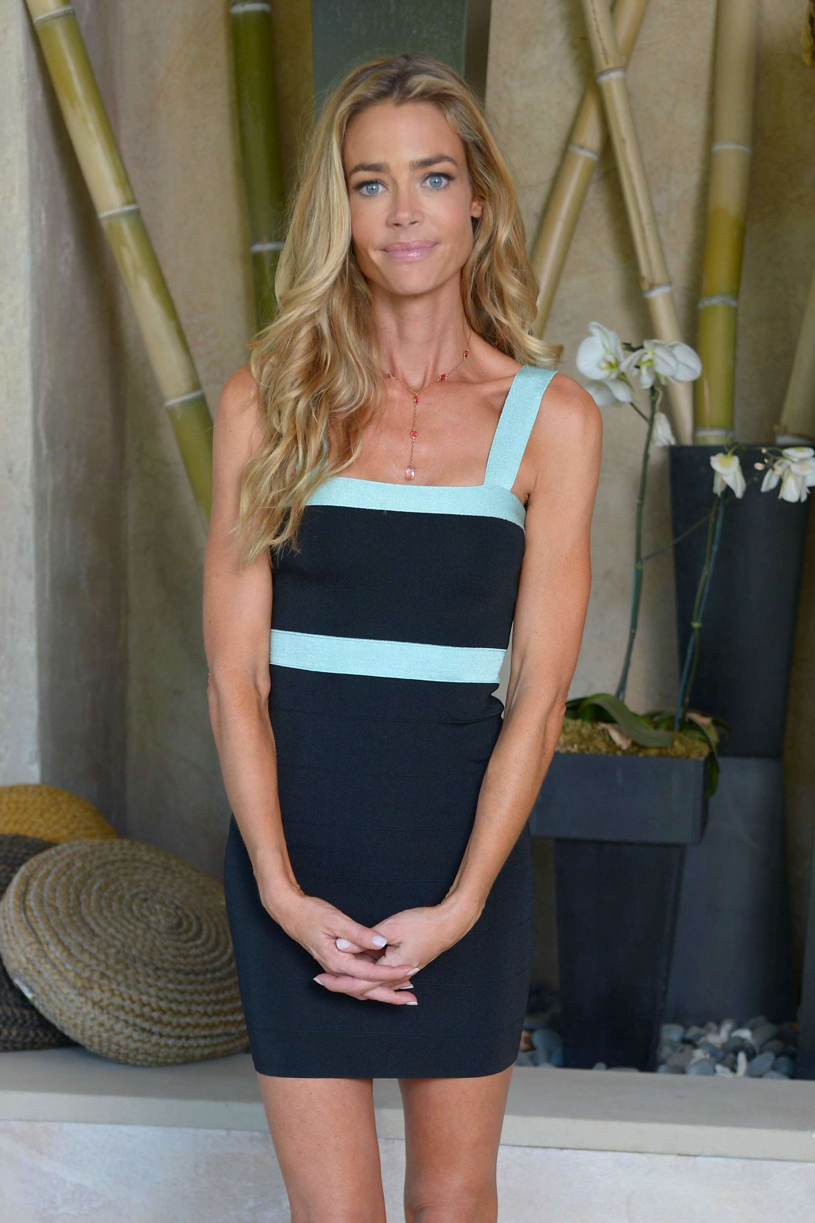 Denise Richards in a Kardashian Kollection dress in