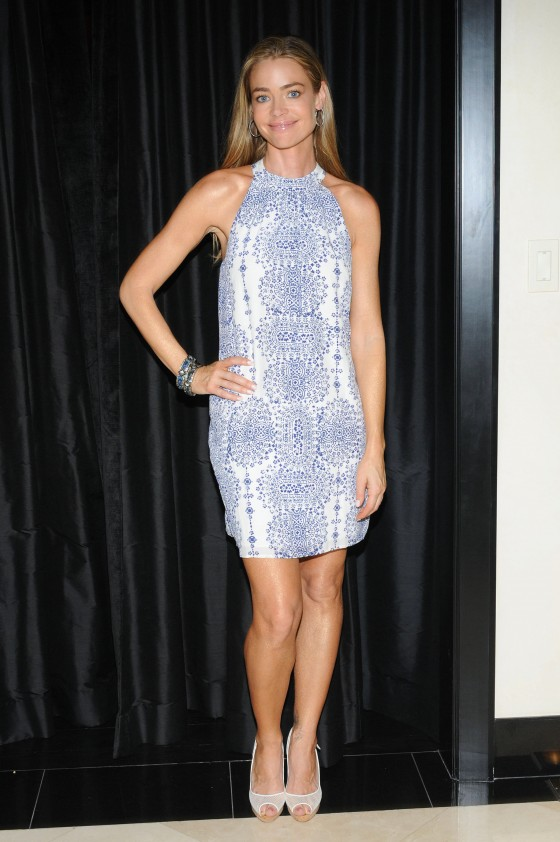 "Denise Richards in a short dress promoting ""Denise Richards Volume Extend"" hair care line in LA"