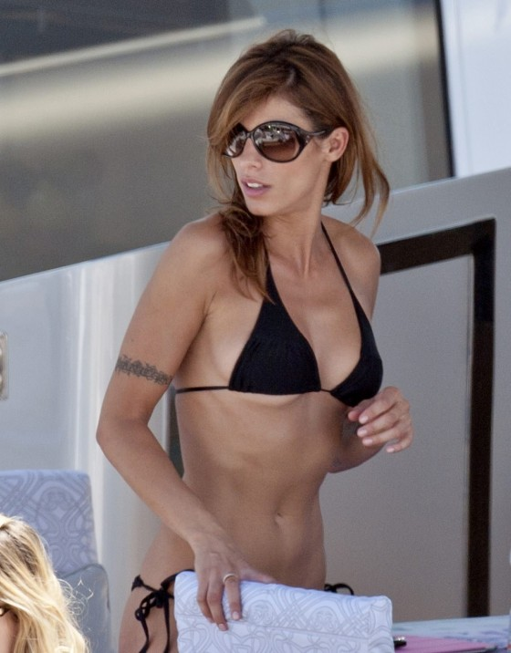 Elisabetta Canalis - in a thong bikini on a yacht in cannes
