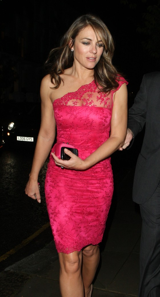 Elizabeth Hurley showing her body in tight dress returning home in Chelsea