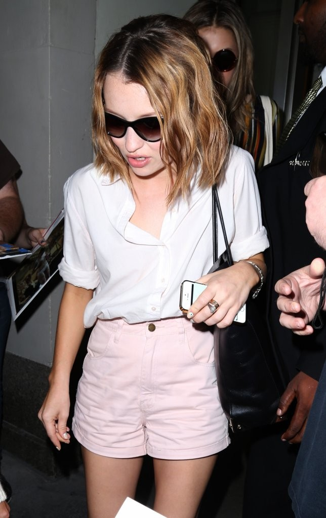 Emily Browning in Shorts Arrives in NY