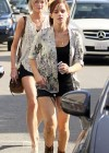 Emma Watson - shows off her legs in a shorts running for a cab at Intermix boutique