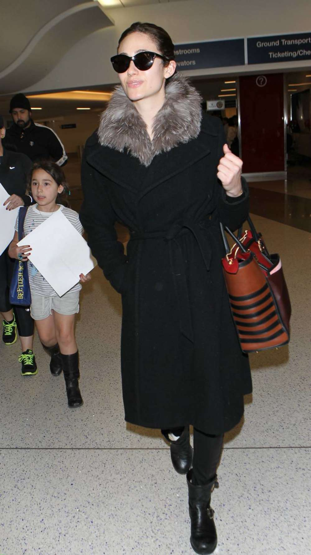 Emmy Rossum in Black Coat Arrives at LAX Airport in LA