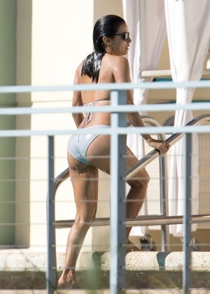 Eva Longoria in a bikini at a pool in Miami