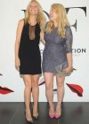 Gwyneth Paltrow Showing legs in a short black dress at The Conversation Launch Celebration in NYC