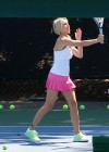 heather-locklear-leggy-candids-in-a-pink-skirt-at-the-malibu-country-club-04