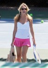 Heather Locklear shows her legs in a pink skirt and pigtails enjoys her tennis lesson at the Malibu Country Club