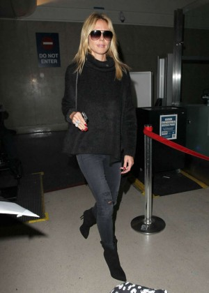 Heidi Klum in Tights Arrives at LAX Airport in LA