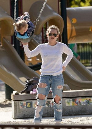Hilary Duff in Ripped Jeans at the park with Luca in LA
