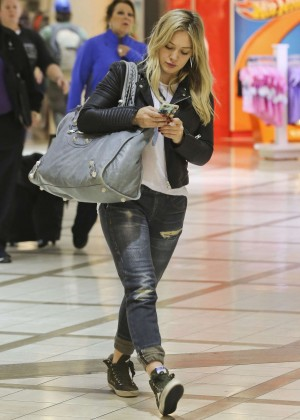 Hilary Duff in Ripped jeans at LAX airport in LA