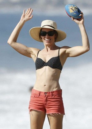 Hilary Swank in Red Shorts and Bikini Top at a beach in Malibu