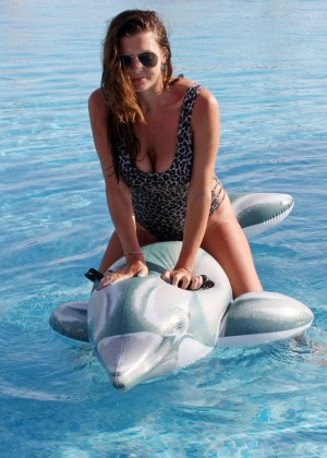 Imogen Thomas in leopard print swimsuit in Sicily
