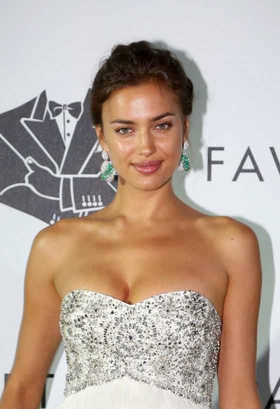 Irina Shayk shows her cleavage in long dress at Fawaz Gruosis 60th Birthday Party in Italy
