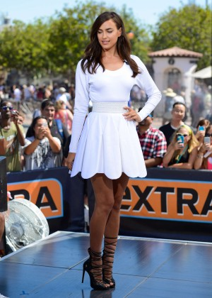 Irina Shayk in White Dress on the set of 'Extra' in Universal City