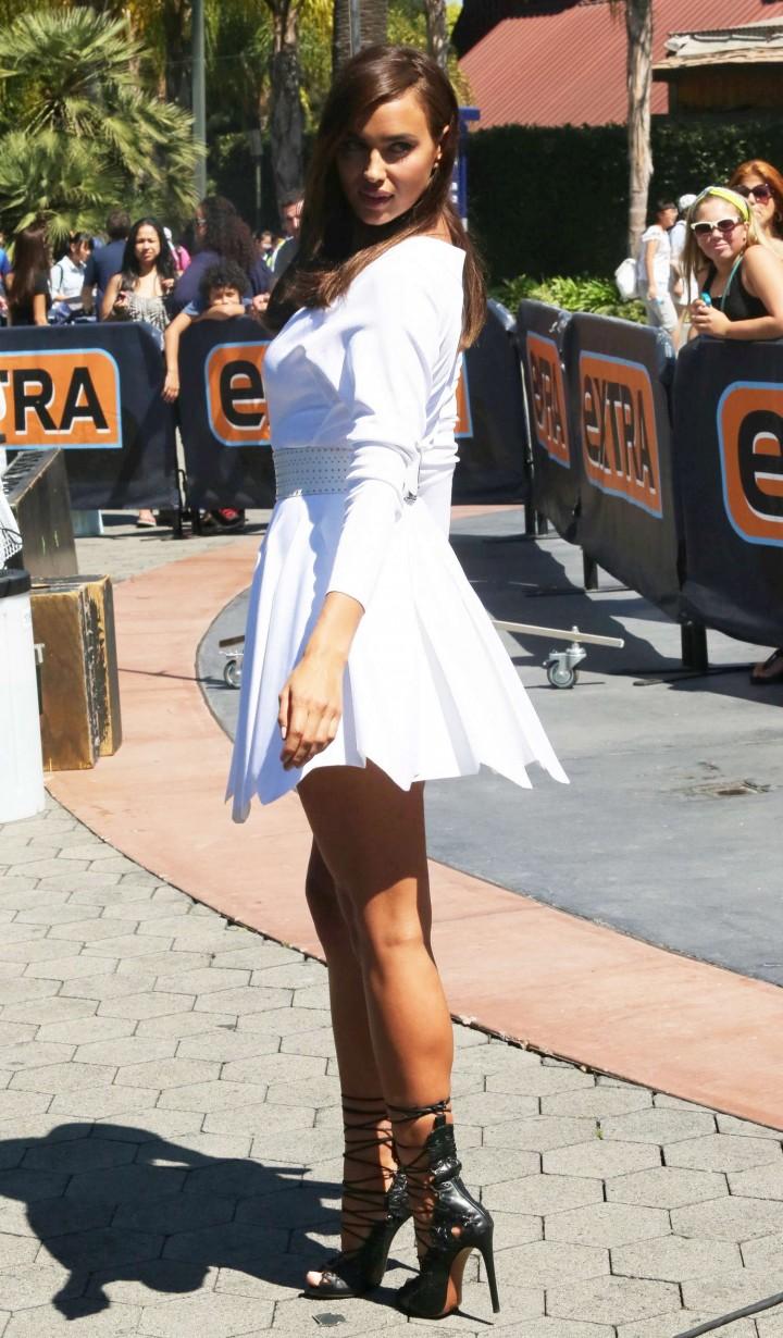 Irina Shayk in White Dress on Extra Set -41