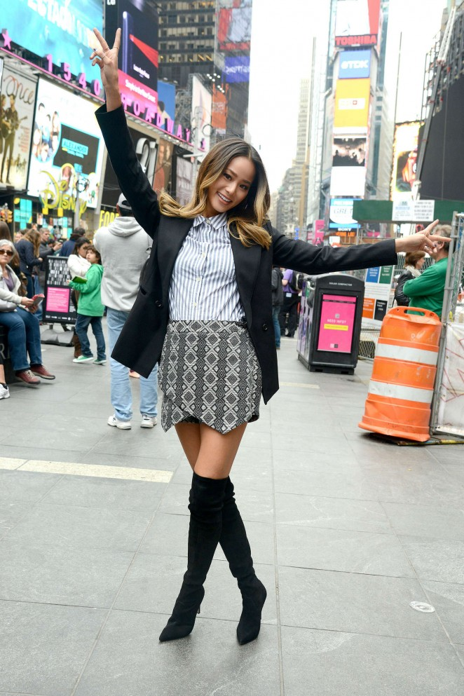 Jamie Chung in Mini Skirt at Old Navy's 20th birthday #selfiebration in Times Square, NY