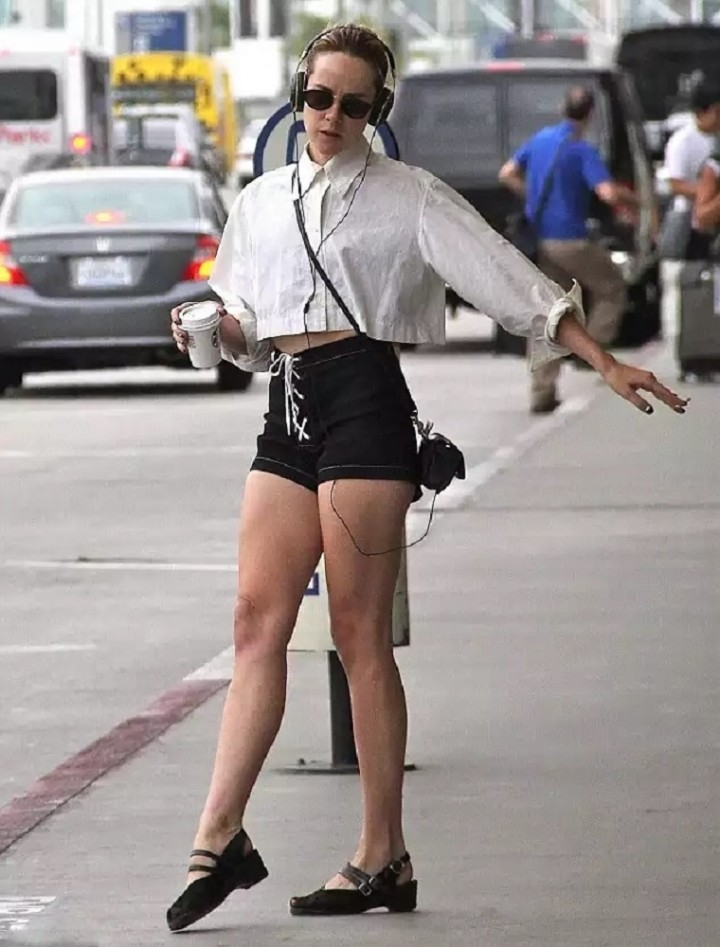 Jena Malone in Shorts - Dancing and Singing Outside LAX Airport