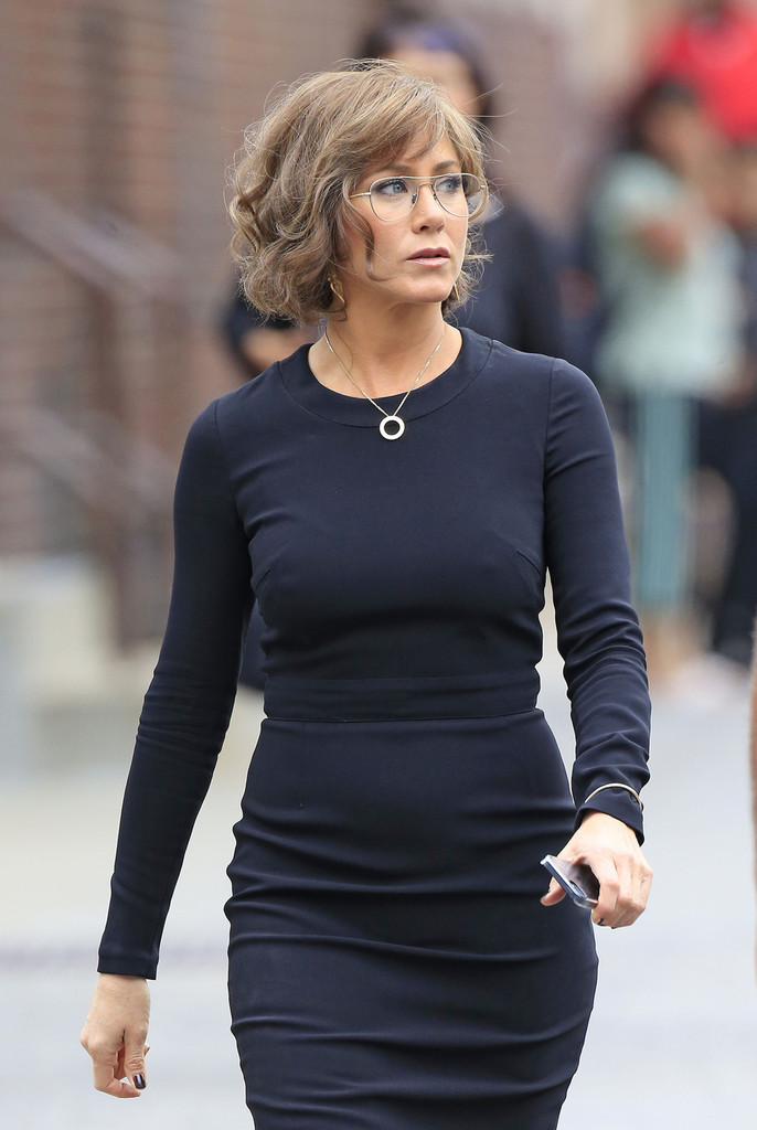 jennifer aniston in black dress on squirrels with nuts set