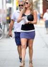 Jennifer Aniston hot in purple mini skirt -05