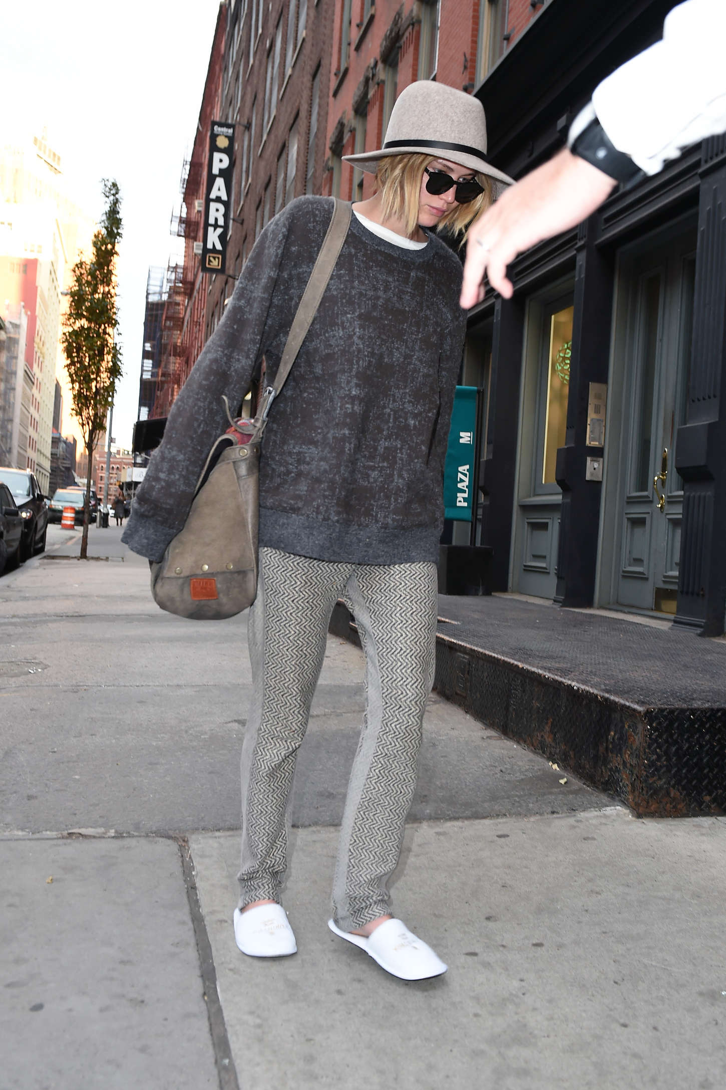 Jennifer Lawrence in White Slippers - Arriving at her hotel in New York City