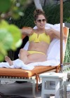 Jennifer Lopez - wearing a yellow bikini at a hotel pool in Miami
