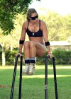 Jennifer Nicole Lee - Black Sports bra and tiny shorts for workout in a park in Miami-12
