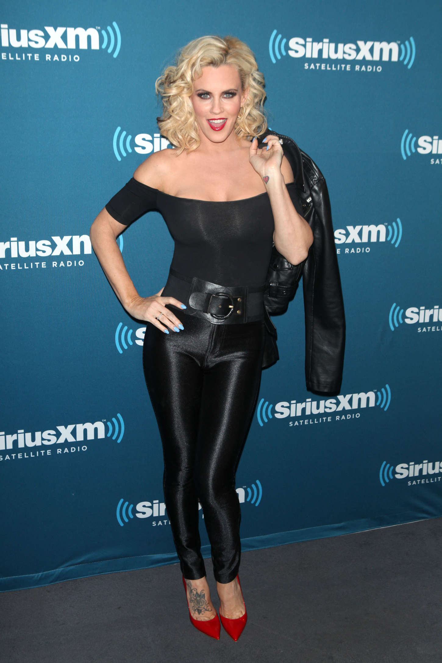 jenny mccarthy in leather pants hosts a halloween