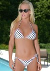 Jenny McCarthy in Albert Michael bikini photoshoot at a pool in Chicago