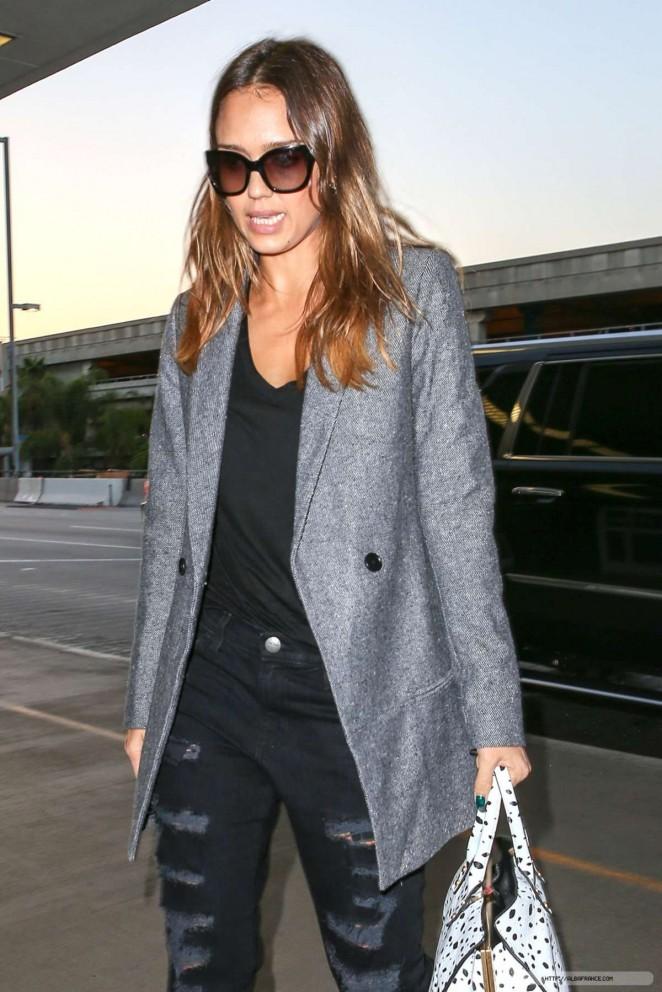 Jessica Alba in Ripped Jeans at LAX in LA