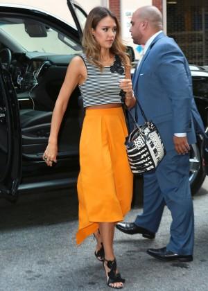 Jessica Alba in yellow skirt.-01