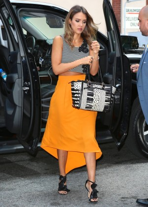 Jessica Alba in yellow skirt.-02