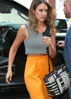 Jessica Alba in yellow skirt.-06