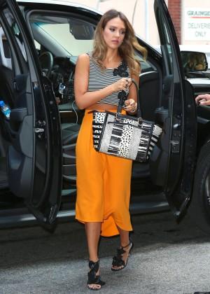 Jessica Alba in yellow skirt.-10