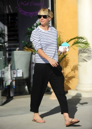 Kaley Cuoco in Black Pants Leaves a nail salon in Los Angeles